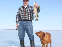 """Neil, his dog Penny, and and Neil's Pigeon Lake """"horse soldier."""""""