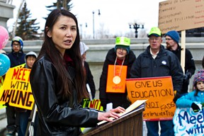 Dr. Nhung Tran-Davies leads a rally to support a petition calling for math curriculum reform at the Alberta Legislature Building in Edmonton, Alta., on Saturday, April 12, 2014. Codie McLachlan/Edmonton Sun/QMI Agency