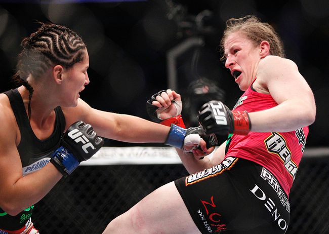 Sarah Kaufman (red gloves) fights against Jessica Eye (blue gloves) in their women's bantamweight bout during UFC 166 at Toyota Center. (Andrew Richardson/USA TODAY Sports)