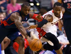 Raptors forward Terrence Ross (right) steals the ball from Pistons guard Rodney Stuckey on Sunday afternoon in Detroit. (Rick Osentoski/USA TODAY Sports)