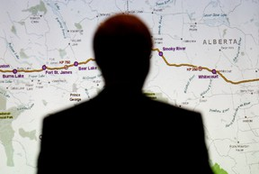 Enbridge counsel Rick Neufeld is silhouetted against a map of the Northern Gateway pipeline, as he takes part in the Enbridge Northern Gateway Project Joint Review Panel hearings in Edmonton on Sept. 4, 2012. (DAVID BLOOM/QMI AGENCY)