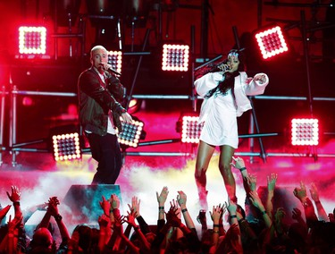 Eminem and Rihanna perform on stage at the 2014 MTV Movie Awards in Los Angeles, California  April 13, 2014. (REUTERS/Lucy Nicholson)