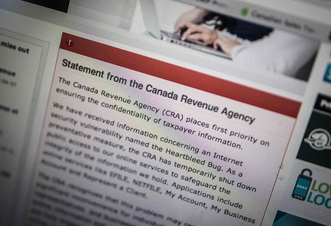 "The Canada Revenue Agency website is seen on a computer screen displaying information about an internet security vulnerability called the ""Heartbleed Bug"" in Toronto, April 9, 2014. (REUTERS/Mark Blinch)"