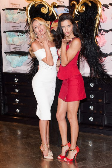 Candice Swanepoel and Adriana Lima at the press announcement for Victoria's Secret Fashion Show at the Bond Street store in London. (Daniel Deme/WENN.com)