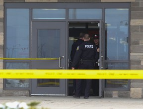 Peel Regional officers enter St. Roch Catholic Secondary School in northwest Brampton after a stabbing Tuesday April 15, 2014. (Jack Boland/Toronto Sun)