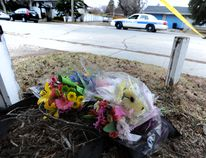 People leave flowers at the murder scene at Butler Cres. in NW Calgary, Alberta where five people have been confirmed dead in a stabbing incident at a house party on Tuesday April 15, 2014. Stuart Dryden/Calgary Sun/QMI Agency