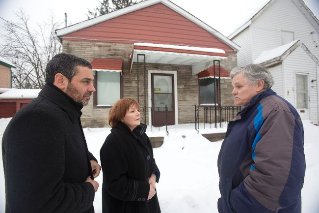 George McNeish, head of the Fugitive Slave Chapel Preservation Project, right, tours the building with local MP Irene Mathyssen and heritage critic Pierre Nantel. A sod-turning is set for May 17.  (Free Press file photo)