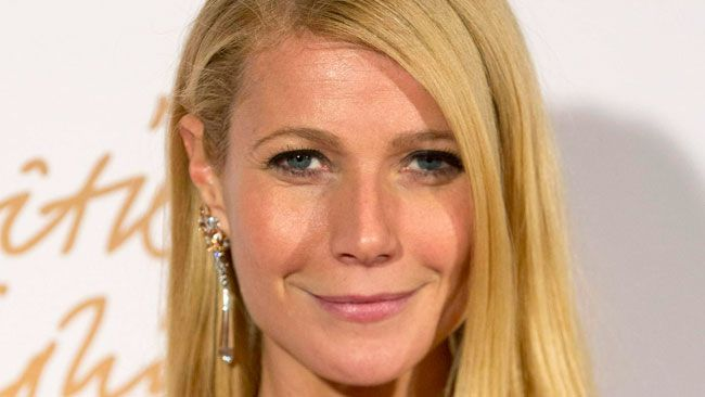 U.S. actress Gwyneth Paltrow poses at the British Fashion Awards in London December 2, 2013. (REUTERS/Neil Hall)