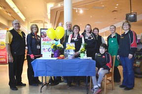 Donna (far right) and Melissa Pickle (sitting), along with Spruce Grove Safeway employees during the Easter Seals campaign kickoff on April 12 in the Grove. - Thomas Miller, Reporter/Examiner