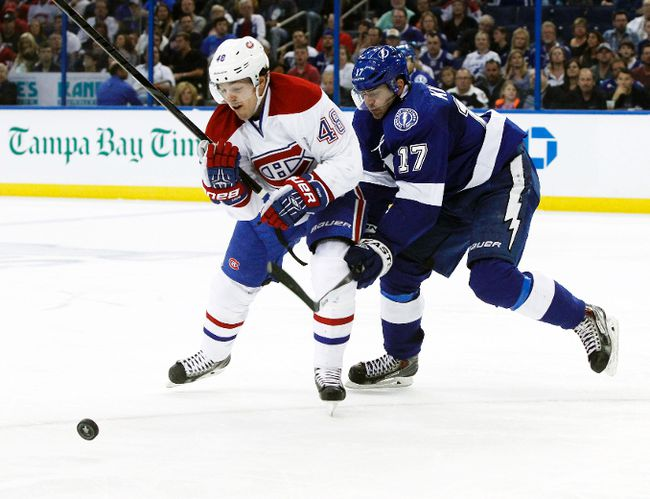 Montreal Canadiens centre Daniel Briere and Tampa Bay Lightning centre Alex Killorn skate for the puck during Game 1 of their Atlantic Division semifinal series at the Tampa Bay Times Forum in Tampa, Fla., April 16, 2014. (KIM KLEMENT/USA Today)