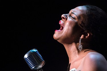 """Audra McDonald cries as she performs the song """"Strange Fruit"""" as Billie Holiday in the production of """"Lady Day at Emerson's Bar and Grill"""" at the Circle in the Square Theatre in New York March 24, 2014.   REUTERS/Andrew Kelly"""