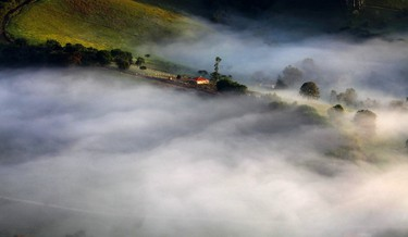 Fog sourrounds a farm in the mountains in Goncalves, in the state of Minas Gerais in southwestern Brazil, April 18, 2014. REUTERS/Paulo Whitaker