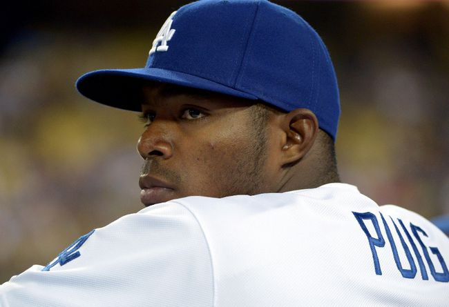 Los Angeles Dodgers right fielder Yasiel Puig watches from the dugout during a game against the San Francisco Giants at Dodger Stadium. (Kirby Lee/USA TODAY Sports)