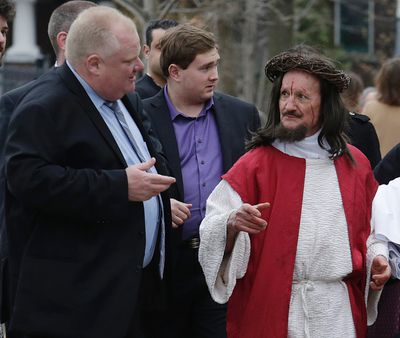 """Mayor Rob Ford with """"Jesus"""" during the Good Friday Stations of the Cross parade in Little Italy April 18, 2014. (Craig Robertson/Toronto Sun)"""