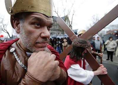 Stations of the Cross parade on College St. on Friday April 18, 2014. (Craig Robertson/Toronto Sun)