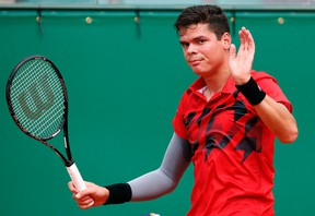 Milos Raonic of Canada reacts after missing a point during his match against Stanislas Wawrinka of Switzerland during their quarter-final match at the Monte Carlo Masters in Monaco April 18, 2014. (REUTERS/Eric Gaillard)