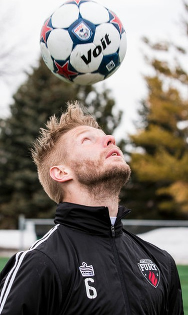 Ottawa Fury FC captain Richie Ryan heads the ball during a training session at Carleton University. The team plays it's first ever home game on Saturday. April 18,2014. Errol McGihon/Ottawa Sun/QMI Agency