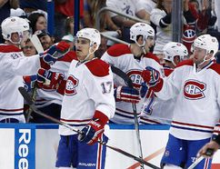 Montreal Canadiens left wing Rene Bourque (17) celebrates with teammates after scoring a goal against the Tampa Bay Lightning during the second period in game two of the first round of the 2014 Stanley Cup Playoffs at Tampa Bay Times Forum on Apr 18, 2014 in Tampa, FL, USA . (Kim Klement/USA TODAY Sports)
