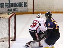 Kirkland Lake Gold Miners' forward Everett Thompson scores to make it a 3-1 game during the third period of game four in the NOJHL championship final. The Miners went on to win the contest 4-1.