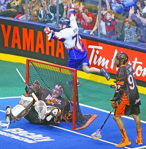Toronto Rock forward Kevin Ross celebrates his goal on Buffalo Bandits goaltender Anthony Cosmo on Friday night at the ACC. (DAVE ABEL/Toronto Sun)