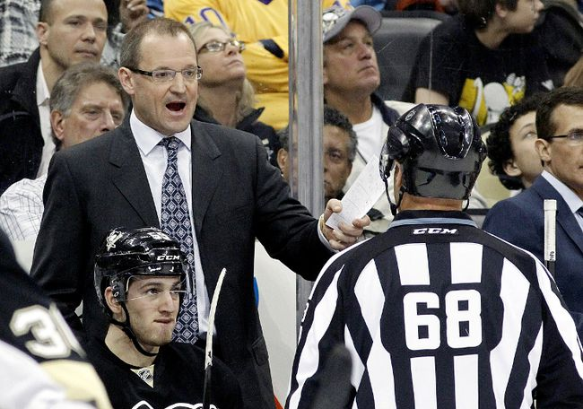 Pittsburgh Penguins head coach Dan Bylsma (top left) reacts to linesman Scott Driscoll (68) after a Penguins goal was disallowed for goal tender interference against the Los Angeles Kings during the third period at the CONSOL Energy Center on Mar 27, 2014 in Pittsburgh, PA, USA. (Charles LeClaire/USA TODAY Sports)