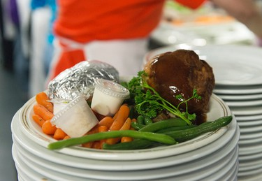 OTTAWA, Ont. (21/04/14) - The Mission expects to serve close to 3000 meals at it's annual Easter dinner on Monday. The kitchen has 2300 pounds of prime rib, 2000 yorkshire puddings, 3000 baked potatoes, 400 pounds of carrots and 400 pounds of green beans for the meals. Sarah Taylor/Ottawa Sun/QMI Agency