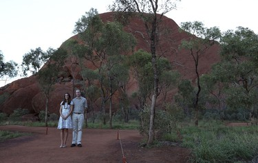 Britain's Prince William walks with Catherine, Duchess of Cambridge (R), along the Kuniya walk near Uluru in the Northern Territory on April 22, 2014. Britain's Prince William, his wife Kate and their son Prince George are on a three-week tour of New Zealand and Australia. AFP Photo/Rob Griffith/Pool