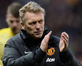 In this file picture taken on February 1, 2014 Manchester United's Scottish manager David Moyes leaves the pitch after the English Premier League football match between Stoke City and Manchester United at Britannia Stadium. (AFP PHOTO/ANDREW YATES)