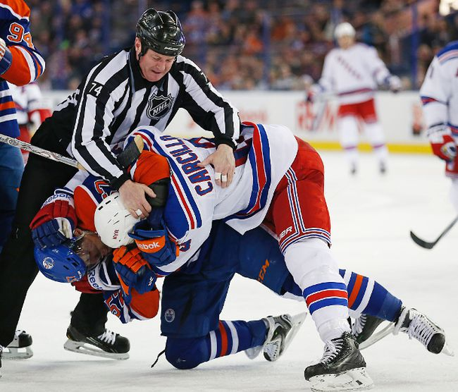 Edmonton Oilers forward David Perron and New York Rangers forward Dan Carcillo fight during the third period at Rexall Place. (Perry Nelson/USA TODAY Sports)