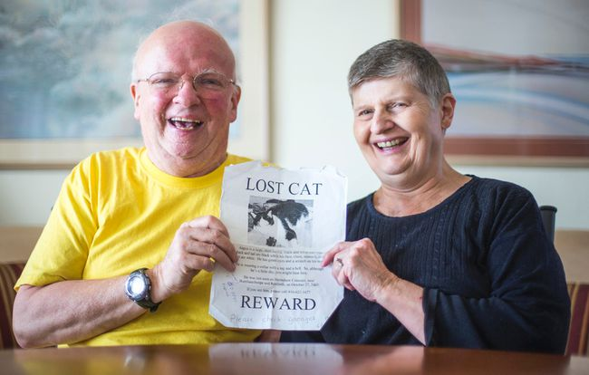 Mary and David Dalton at their Toronto, Ont.  home on Tuesday April 22, 2014.  They were recently reunited with their cat Angus - who was missing for 8 years. The microchip they had put in allowed him to be traced back to them after all these years.  Ernest Doroszuk/Toronto Sun/QMI Agency