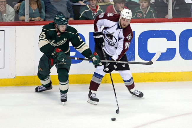 Colorado Avalanche forward Ryan O'Reilly (90) passes around Minnesota Wild defenceman Jonas Brodin (25) during the second period in game three of the first round of the 2014 Stanley Cup Playoffs at Xcel Energy Center. (Brace Hemmelgarn-USA TODAY Sports)