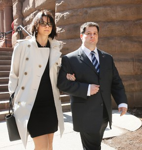 Toronto Police Const. James Forcillo, with wife Irini, leaves Old City Hall in Toronto Tuesday, April 22, 2014 after a preliminary hearing into the shooting death of Sammy Yatim aboard a TTC streetcar last July. (Stan Behal/Toronto Sun)