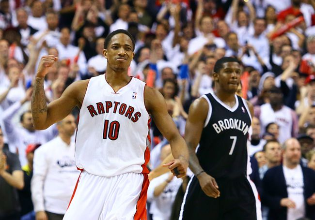 DeMar DeRozan of the Toronto Raptors celebrates the win over the Brooklyn Nets during game 2 of the Eastern Conference Playoffs at the Air Canada  in Toronto, Ont. on Tuesday April 22, 2014. Dave Abel/Toronto Sun/QMI Agency