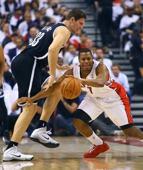 Kyle Lowry of the Toronto Raptors gets around Mirza Teletovic of the Brooklyn Nets during Game 2 of the Eastern Conference playoff series on April 22, 2014. (Dave Abel/Toronto Sun/QMI Agency)