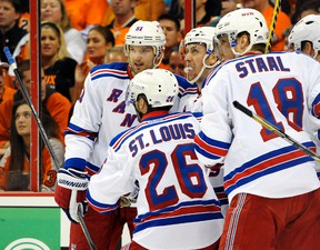 New York Rangers centre Derek Stepan celebrates with left wing Rick Nash (left), right wing Martin St. Louis, and defenceman Marc Staal after scoring a goal against the Philadelphia Flyers in Game 3 of their Eastern Conference quarterfinal series at the Wells Fargo Center in Philadelphia, April 22, 2014. (ERIC HARTLINE/USA Today)