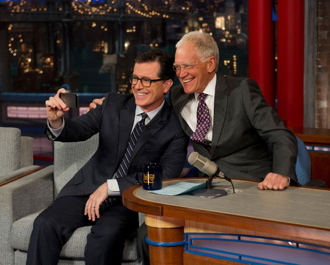 "Stephen Colbert and David Letterman pose for a selfie on ""The Late Show with David Letterman""."