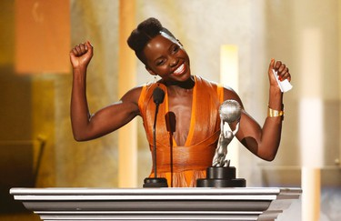 Actress Lupita Nyong'o was named by People Magazine as World's Most Beautiful Woman. See 5 of our favourite looks for the Oscar winner. (REUTERS/Danny Moloshok)