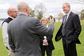 Dr. Colin Carrie, Member of Parliament for Oshawa and Parliamentary Secretary to the Minister of the Environment, right, speaks to Northumberland-Quinte West MP Rick Norlock, Glenda Rodgers of Lower Trent Conservation and Terry Murphy of Quinte Conservation, Wednesday at the Bay of Quinte Golf Club.  Emily Mountney/The Intelligencer