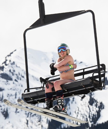 A skier braves the cold while riding a chairlift during the Bikini & Board Shorts Downhill at Crystal Mountain, a ski resort near Enumclaw, Washington April 19, 2014. (REUTERS/David Ryder)