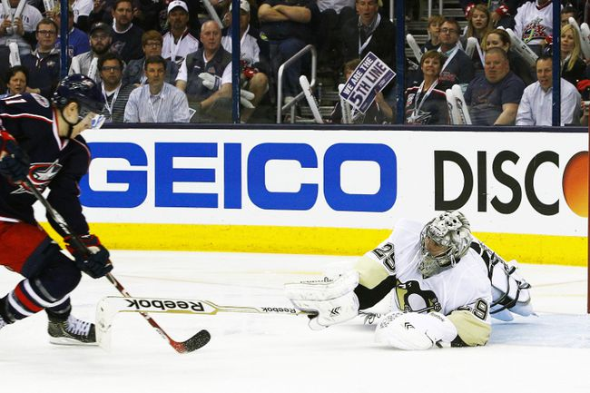 Pittsburgh Penguins goalie Marc-Andre Fleury poke checks the puck from Columbus Blue Jackets left wing Matt Calvert during Game 3 of their Eastern Conference quarterfinal series at Nationwide Arena in Columbus, April 23, 2014. (RUSSELL LaBOUNTY/USA Today)