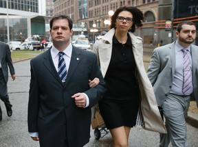 Toronto Const. James Forcillo, wife Irini and lawyer Peter Brauti arrive at Old City Hall Tuesday, April 22, 2014, for his preliminary hearing for second-degree murder charge in Sammy Yatim shooting on TTC streetcar. (Stan Behal/Toronto Sun)