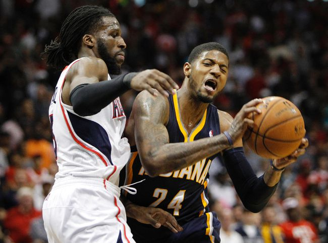 Indiana Pacers forward Paul George is defended by Atlanta Hawks forward DeMarre Carroll during Game 3 of their Eastern Conference quarterfinal series at Philips Arena in Atlanta, April 24, 2014. (BRETT DAVIS/USA Today)