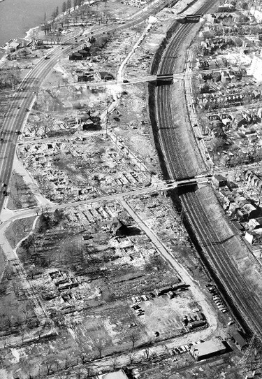 Mike Filey's The Way We Were for April 27, 2014... This February 1957 aerial view shows the decimation of the community of south Parkdale as crews cleared the way for the new Lakeshore (soon to be renamed Frederick G. Gardiner) Expwy. The trio of bridges convey (top to bottom) the Dunn, Jameson and Dowling thoroughfares to and from Lake Shore Blvd. and the waterfront. The curved street south of the railway corridor is Empress Cres.