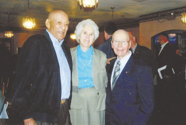 Former U.S. sailor Lanier Phillips, left, was rescued by residents of St. Lawrence, N.L., when his ship, the USS Truxton, ran aground on rocks and sank in February, 1942. He struck a lifelong friendship with one of his rescuers, Levi Pike and his wife, Millie. Both men, above at a gathering in 2008, are featured in the play, Oil and Water, now on stage at the Grand Theatre. (Special to QMI Agency)