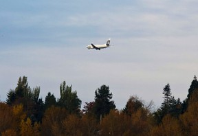 An Alaska Airlines plane approaches Seattle-Tacoma International Airport in SeaTac, Washington in this October 30, 2013 file photo. (REUTERS/Jason Redmond)