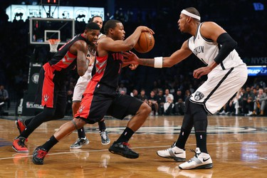 Brooklyn Nets forward Paul Pierce (34) defends Toronto Raptors guard Kyle Lowry (7) during the second quarter of Game 3 on April 25. (Anthony Gruppuso-USA TODAY Sports)