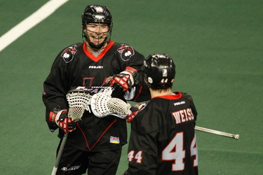 Vancouver transition Tyler Garrison (91) celebrates his goal with transition Nick Weiss (44) as the Edmonton Rush play the Vancouver Stealth at Crystal Glass Field at Rexall Place in Edmonton, Alta., on Friday, April 25, 2014. The Rush held a Tribute to the Stollery Night on Friday where Captain Canada, and former Edmonton Oiler, Ryan Smyth attended and the team wore special jerseys. Ian Kucerak/Edmonton Sun/QMI Agency