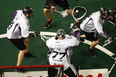 Edmonton goalie Aaron Bold (77) makes a save against Vancouver as the Edmonton Rush play the Vancouver Stealth at Crystal Glass Field during the second half of the game at Rexall Place in Edmonton, Alta., on Friday, April 25, 2014. The Rush held a Tribute to the Stollery Night on Friday where Captain Canada, and former Edmonton Oiler, Ryan Smyth attended and the team wore special jerseys. Ian Kucerak/Edmonton Sun/QMI Agency