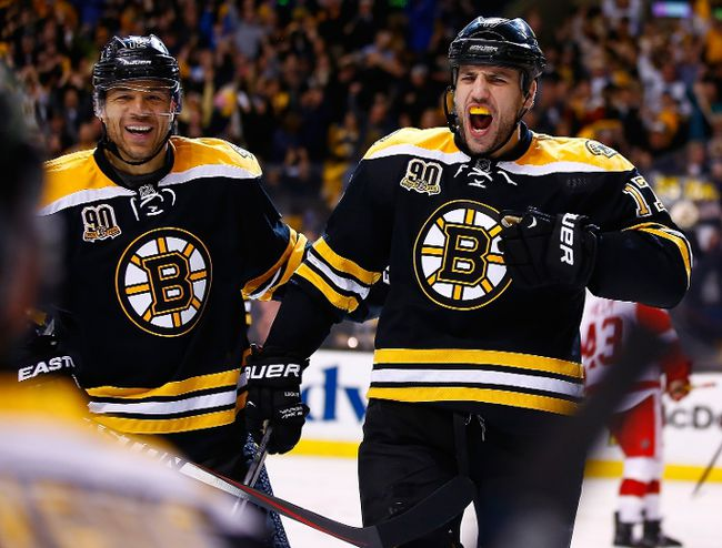 Milan Lucic of the Boston Bruins celebrates his goal past Jonas Gustavsson of the Detroit Red Wings with teammate Jarome Iginla in the third period in Game 5 at TD Garden on April 26, 2014. (Jared Wickerham/Getty Images/AFP)