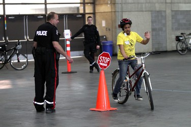 Cst. R. Ross gives out instructions at the Bike Safety Festival at the Edmonton Expo Centre  in Edmonton Alta., on Saturday April 26, 2014.  Perry Mah/Edmonton Sun/QMI Agency